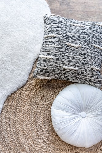 different texture rug and pillow decor