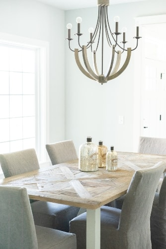 White Slipcover Chairs and Modern Chandelier